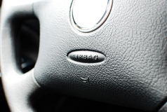 Airbag caption. SRS airbag caption on car dashboard wheel Stock Photo