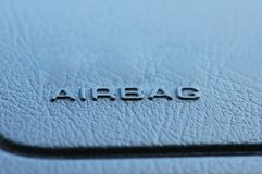 Airbag caption. On the car  leather dashboard Royalty Free Stock Photography