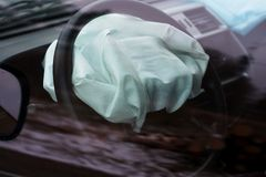 Airbag exploded at car accident. Car crash and airbag worked well. View through closed window Royalty Free Stock Images