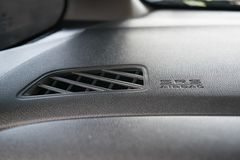 Airbag icon on console of city car. And air conditioner port Royalty Free Stock Photos