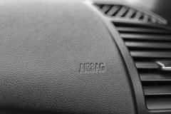 Airbag inner beveled. The word Airbag is inner beveled on a car's dashboard Royalty Free Stock Images