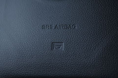 Airbag panel on the rudder of the car. Stock Photos