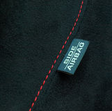 Airbag safety label. Car side airbag safety label. Interior car detail Stock Photography