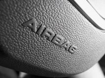 Airbag sign. Close up of airbag symbol on a car steering wheel stock photography