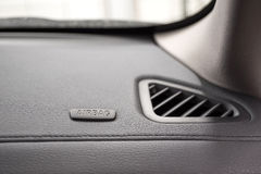 Airbag sign on car dashboard. Stock Image