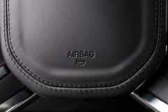 Airbag sign on car wheel. Stock Photo