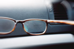 Airbag sign through eyewear glasses Stock Images