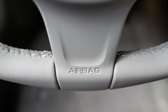 Airbag sign. A Airbag sign on steering wheel Stock Photo