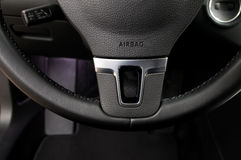 Airbag sign on steering wheel of car. Royalty Free Stock Photo