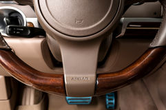 Airbag sign on steering wheel of car. Stock Photos