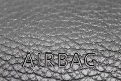 Airbagzeichen auf Armaturenbrett Stockbilder