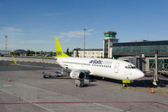 AirBaltic Boeing 737 docked in Riga airport Royalty Free Stock Photo