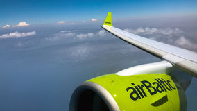 AirBaltic Bombardier CS300 aircraft turbine is flying over Rhodes island Stock Photos