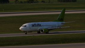 AirBaltic jet plane taxiing in Munich Airport, MUC. AirBaltic plane on runway in Munich Airport, MUC, spring stock video footage