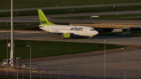 AirBaltic jet plane taxiing in Munich Airport, MUC. AirBaltic plane on runway in Munich Airport, MUC, spring stock video