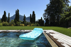 Airbed floating in the pool. Summer day royalty free stock photo