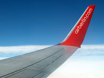 Airberlin airplane in flight. Airplane of the Airberlin company in flight. Background with blue sky and clouds Royalty Free Stock Images