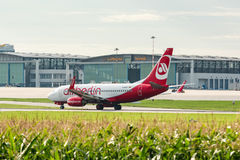 AirBerlin plane in front of Lufthansa hangar at Stuttgart airport Royalty Free Stock Photography