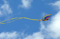 Airborne and free. Gorgeous butterfly kite soars against a vivid blue sky at the Cape Charles, Virginia  bayfront beach park.  Butterfly wings are spread and a Stock Image