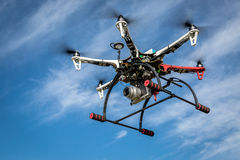 Airborne hexacopter drone carrying camera. FORT COLLINS, CO, USA, JULY 15, 2015: DJI F550 Flame Wheel hexacopter drone flying with the Pentax Lumix GM1 camera royalty free stock photos
