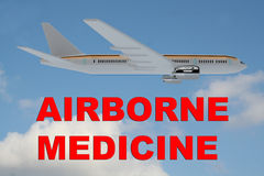 Airborne Medicine concept. 3D illustration of AIRBORNE MEDICINE title on cloudy sky as a background, under an airplane Royalty Free Stock Images