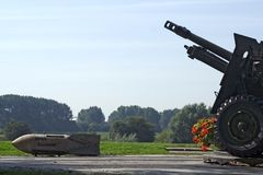 Airborne monument. Remembering Operation Market Garden: A Bridge Too Far in Arnhem, the Netherlands. A 1944 world war II 400kg aeroplane bomb and canon near royalty free stock photography
