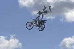 Airborne moto cross driver. Moto cross riders putting on a show at elliot lake drag races Stock Image
