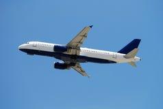 Airborne passenger jet royalty free stock photos