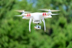 Airborne Quadcopter With Camera. This airborne Quadcopter hovers in position royalty free stock photo