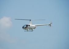 Airborne R-44 helicopter Royalty Free Stock Photo