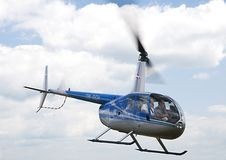 Airborne Robinson R-44 helicopter Royalty Free Stock Image