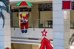 Airborne Santa Claus. In the building royalty free stock photo
