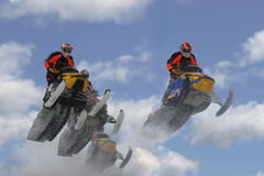 Airborne snowmobilers royalty free stock image