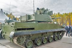 Airborne tracked armoured vehicle BMD-4M. Nizhniy Tagil, Russia - September 25 2013: Visitors examine military equipment on exhibition range. Airborne tracked Stock Images