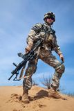 Airborne. United states airborne infantry man with arms, camo uniforms dress. Combat helmet, knee pads protection wearing, low angle view from below, full body royalty free stock image
