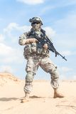 Airborne. Portrait of United states airborne infantry marksman with arms, camo uniforms dress. Combat helmet on, face mask, full body royalty free stock images