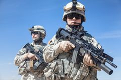 Airborne. Two United states airborne infantry men with arms, camo uniforms dress. Front view, half length royalty free stock photos