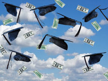 airborned graduation caps with cash Royalty Free Stock Images