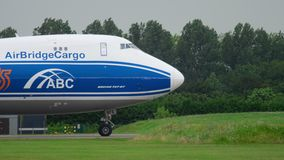 AirBridgeCargo Boeing 747 taxiing before take-off. AMSTERDAM, THE NETHERLANDS - JULY 25, 2017: AirBridgeCargo Boeing 747 VQ-BFE taxiing before take-off at stock footage