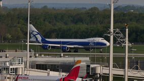 AirBridgeCargo plane taking off. AirBridgeCargo takes off from beyond the buildings. Munich Airport MUC stock video