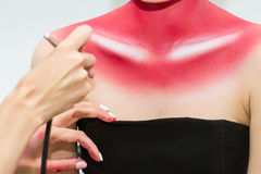Airbrush body painting. Stock Photos