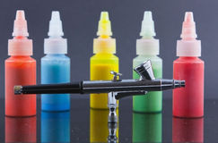 Airbrush in front of out of focus paint Stock Photography
