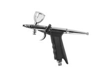 Airbrush gun on white background Stock Photos