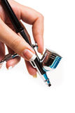 Airbrush in hand Royalty Free Stock Image
