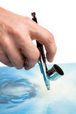 Airbrush in hand Stock Photo
