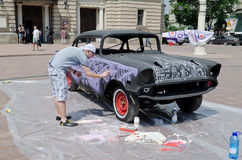 Airbrush painting retro car on display outdoors in Royalty Free Stock Photography