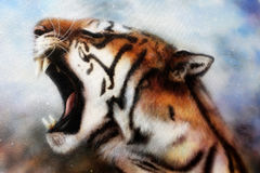 Airbrush painting of a roaring tiger. A beautiful airbrush painting of a mighty roaring tiger emerging from an abstract cosmical background with starlights royalty free illustration