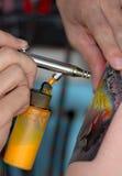 Airbrush Tattoo. Teen airbrush tattoo to arm Stock Image