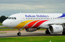 Airbus. Balkan Holidays Airbus A320 taxiing into Manchester Airport stock photography