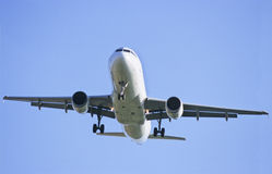 Airbus. Plane landing on a sunny day with blue sky Stock Photography